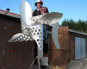 Going for a spin . . . Wind power enthusiast John McCabe shows his new wind turbine sculpture,...