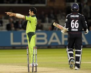 Pakistan's Umar Gul (left) celebrates after claiming the wicket of England's Graeme Swann during...