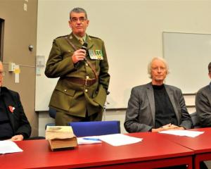 Panel members (from left) Dr George Davis, Associate Prof David McBride, Prof Kevin Clements ...
