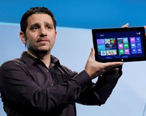 Panos Panay, the general manager of the team behind the Microsoft Surface holds up the new...