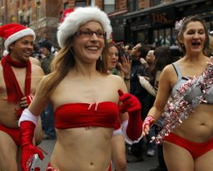 Participants start the annual Santa Speedo Run through the streets of the Back Bay neighbourhood...