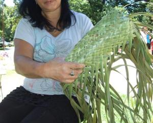 Pauline May, of Frankton, begins a raranga (weaving) demonstration to create a kete (basket)....