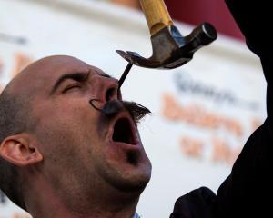 Performance artist Donny Vomit pulls a nail out of his nasal cavity ahead of the sixth annual...