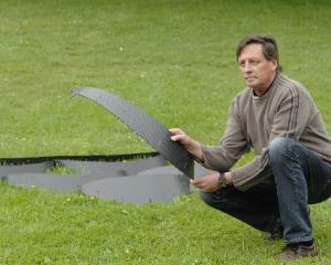 Peter Dunn demonstrates Soil Cell, a system he helped develop that helps with establishing...