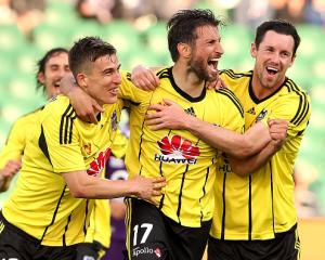 Phoenix players celebrate a goal against Perth at the weekend. Photo Getty