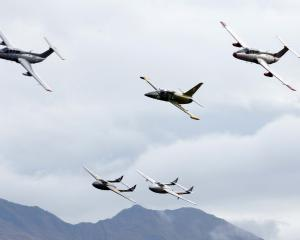 The Gigatown Wanaka jets neck and neck with Mt Roy behind. Photos Stephen Jaquiery