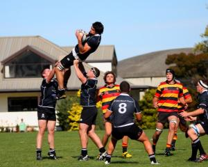 Pirates lock Andrew Johnson takes a kick-off as he is supported by Clinton Garrity (left) and...