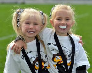 Pirates Rippa rugby players Jemima (6, left) and Lydia Hortop-Blair (4) abuzz after speaking to...