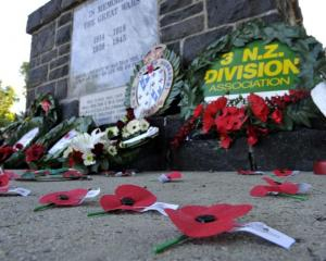 Poppies and wreaths at the Mosgiel war memorial yesterday. Photo by Gerard O'Brien.