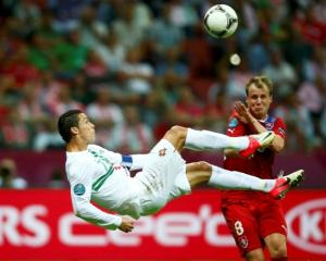 Portugal's Cristiano Ronaldo kicks the ball in front of Czech Republic's Michal Kadlec (R) during...