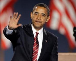 President-elect Barack Obama waves to the crowd after giving his acceptance speech at Grant Park...
