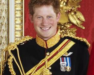 Prince Harry lived up to his larrikin expectation. Photo by AP