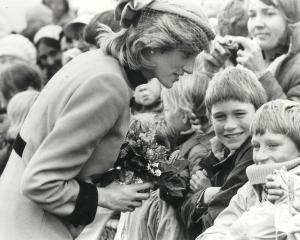 Princess Diana draws shy smiles from a couple of young fans in Dunedin in 1983. Jane Falconer is...