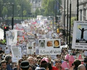 Protesters against Pope Benedict XVI's state visit to Britain march in central London. (AP Photo...