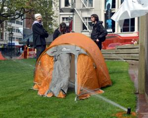 Protesters (from left) Luke Benton, Peter Gutteridge, and Anton Styles re-occupy the Octagon...