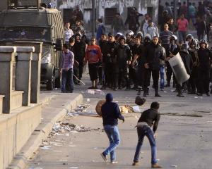 Protesters opposing Egyptian President Mohamed Mursi's rule are seen during clashes with riot...