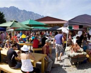 Punters enjoy a summer's day during the Remarkables Market's successful second season. The market...