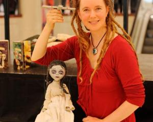 "Puppeteer Asphyxia with ""Martha Grimstone"" in Dunedin yesterday. Photo by Linda Robertson."