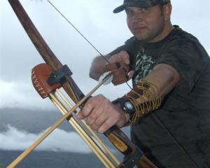 Queenstown bowhunter Paul Mettmann, who wants to start a bowhunting club in the resort, shows off...
