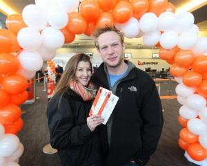 Queenstown visitors Tamsin Scott and Max Marsden, of England, help celebrate Jetstar's milestone...