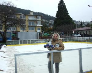 Queenstown Winter Festival manager Lisa Buckingham stands in front of the temporary ice  rink ...