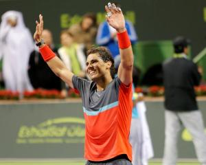 Rafael Nadal celebrates his victory in the Qatar Open final. REUTERS/Ahmed Jadallah