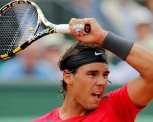 Rafael Nadal of Spain returns the ball to Denis Istomin of Uzbekistan during their match at the...