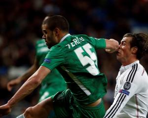 Real Madrid's Gareth Bale gets an elbow in the face from Ludogorets' Georgi Terziev. REUTERS...