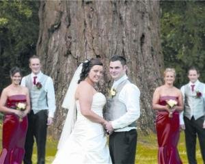 Rebecca Knight and Regan Brown with their wedding party at Mount Stuart Reserve, after their...