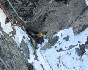Remarkables Ice and Mixed Festival co-ordinator Daniel Joll, of Queenstown, climbs the first...