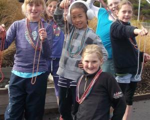Remarkables Primary School pupils with some of the beads that will be for sale during the ...