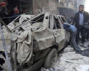 Residents look for survivors after what activists said was an air strike from forces loyal to...