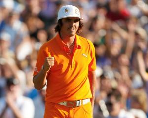 Rickie Fowler of the US pumps his fist after winning the Wells Fargo Championship in Charlotte,...