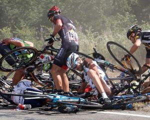 Riders and their bikes on the road following the crash during the 159.5km third stage of the Tour...
