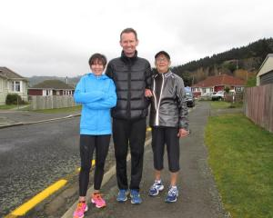 Robbie Johnston,  Stacey Pearson and her mother, Kay, near the finish of the Dunedin Marathon...