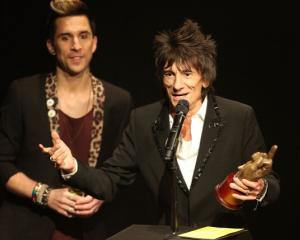 Ronnie Wood accepts the award for Best Music Film for 'Crossfire Hurricane' by the Rolling Stones...