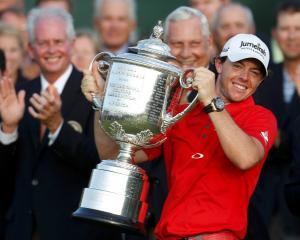 Rory McIlroy of Northern Ireland lifts the Wanamaker Trophy after capturing PGA Championship at...