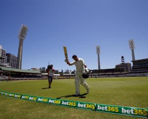 Ross Taylor acknowledges the crowd as he walks off the ground in Perth after being dismissed for...
