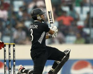 Ross Taylor watches a ball he hit go for six during the Cricket World Cup quarterfinal between...