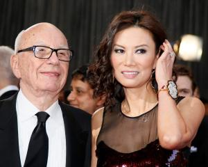 Rupert Murdoch arrives with his wife Wendi Deng at the 85th Academy Awards in Hollywood,...