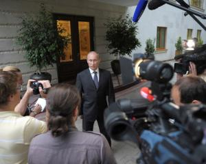 Russian President Vladimir Putin speaks to journalists at the Bocharov Ruchei state residence in...