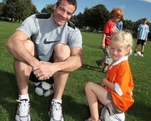 Ryan Nelsen with 4-year-old Lucy Vink at the Cashmere Wanderers Soccer Club in Christchurch...