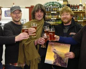 Sampling Bird Dog Pale Ale yesterday are (from left) Castle Macadam owners Alastair McDonald and...