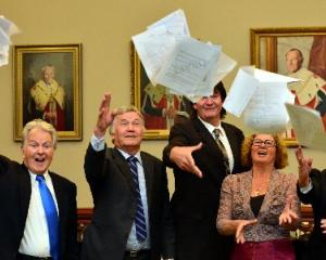 Saying farewell to Dunedin City Council papers yesterday are retiring councillors (from left)...