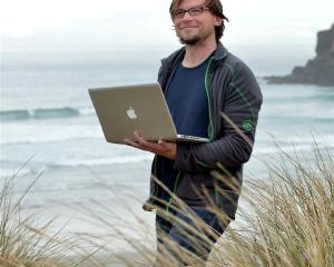Sea lion researcher Stefan Meyer at Tomahawk Beach. Photo by Peter McIntosh.
