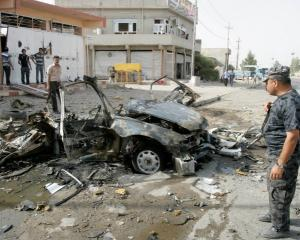 Security personnel inspect the site of a car bomb attack in Kirkuk, 250km north of Baghdad....