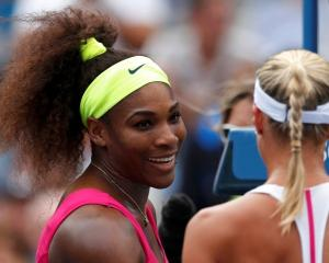 Serena Williams of the US talks to Andrea Hlavackova of the Czech Republic after their women's...