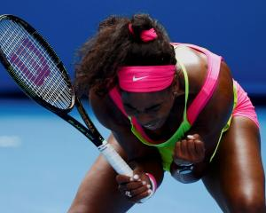 Serena Williams reacts after winning a point against Garbine Muguruza. REUTERS/Issei Kato