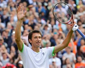 Sergiy Stakhovsky of Ukraine reacts after defeating Roger Federer of Switzerland in their men's...