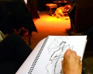 Shirley Symmott sketches while Cheviace Stylet poses in the background at Dr Sketchy's Anti-Art...